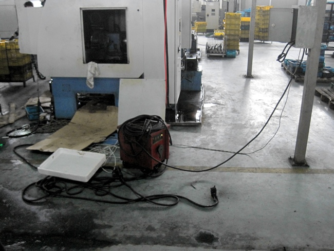 Welding equipment on floor close to water
