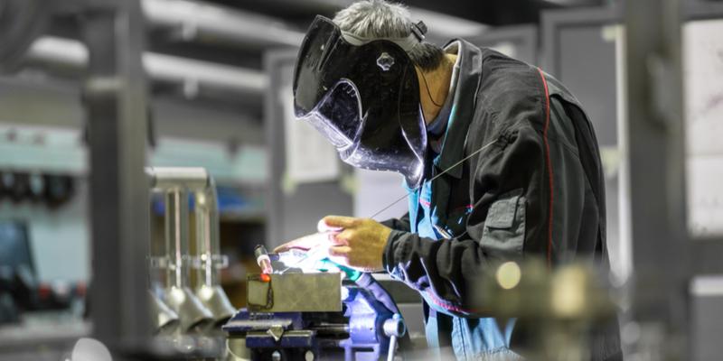 Welder in a manufacturing workshop