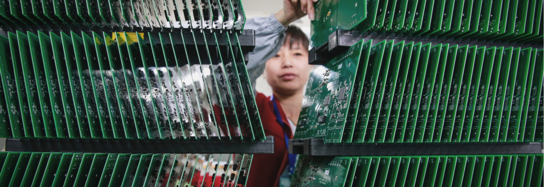 Factory worker checking electronic components