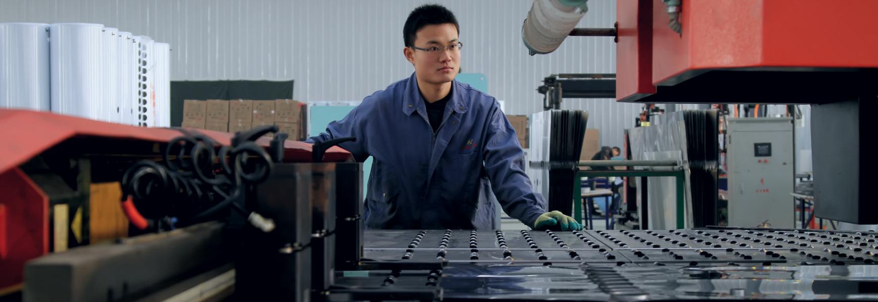 Plant worker inspecting mechanical equipment