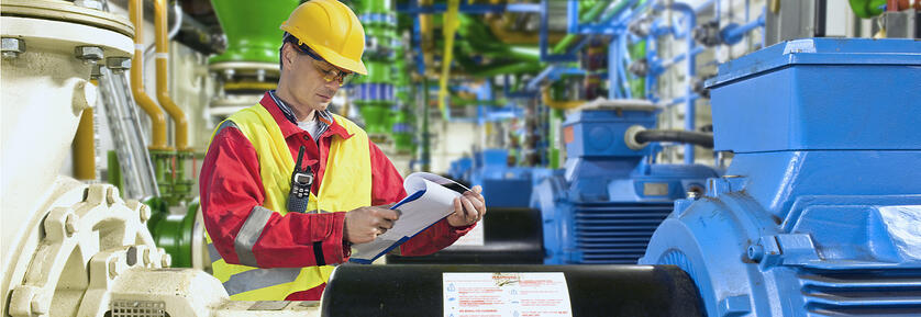 factory engineer analyzing maintenance records
