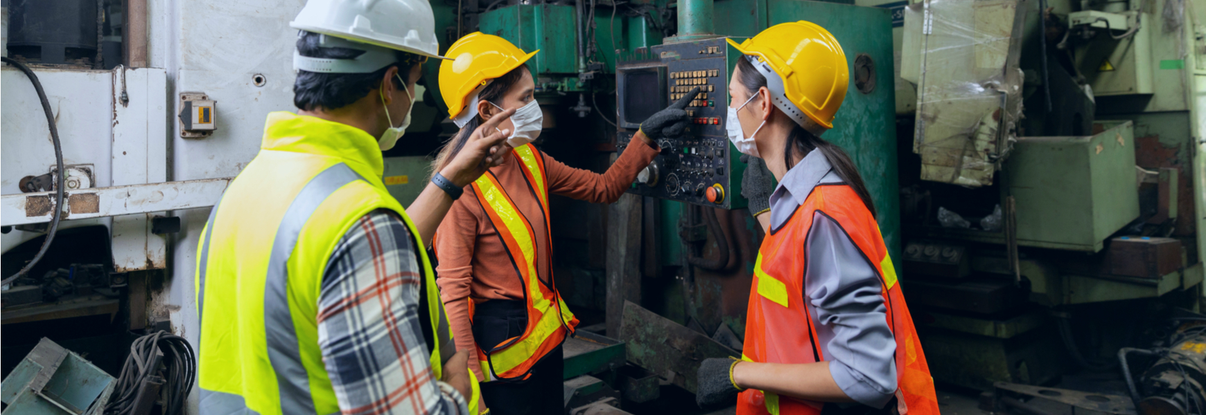 Factory operators learning how to use equipment