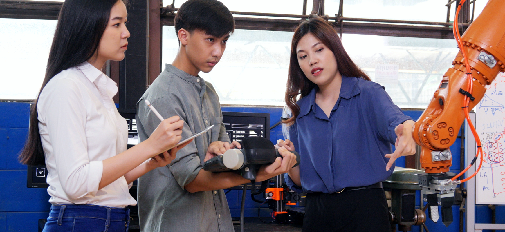 team of engineers discussing modern robotic automation equipment
