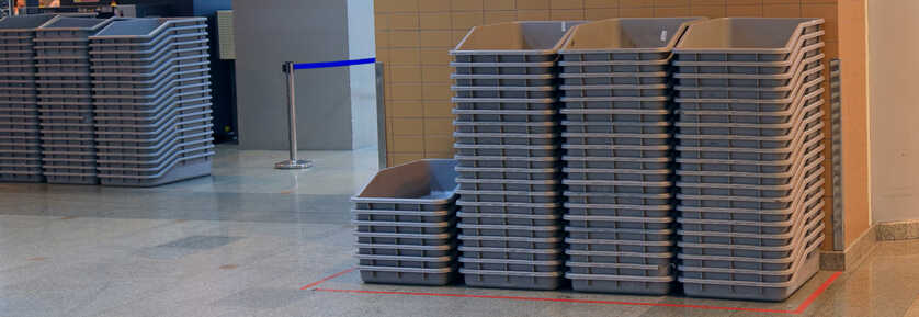 Pile of airport security trays