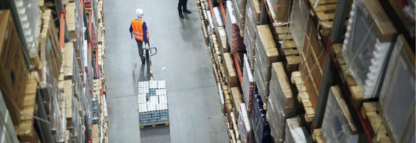 Worker pulling goods inventory in warehouse