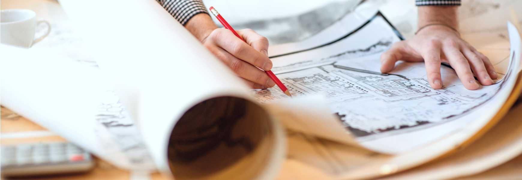 engineer looking over blueprints