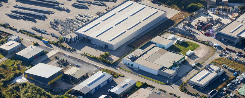 Aerial view of a large factory facility with multiple buildings