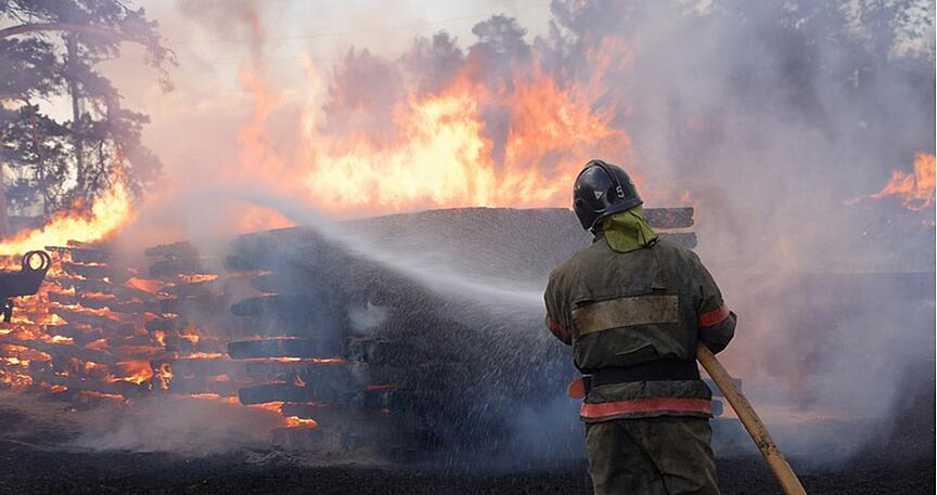 firefighter extinguishing fire