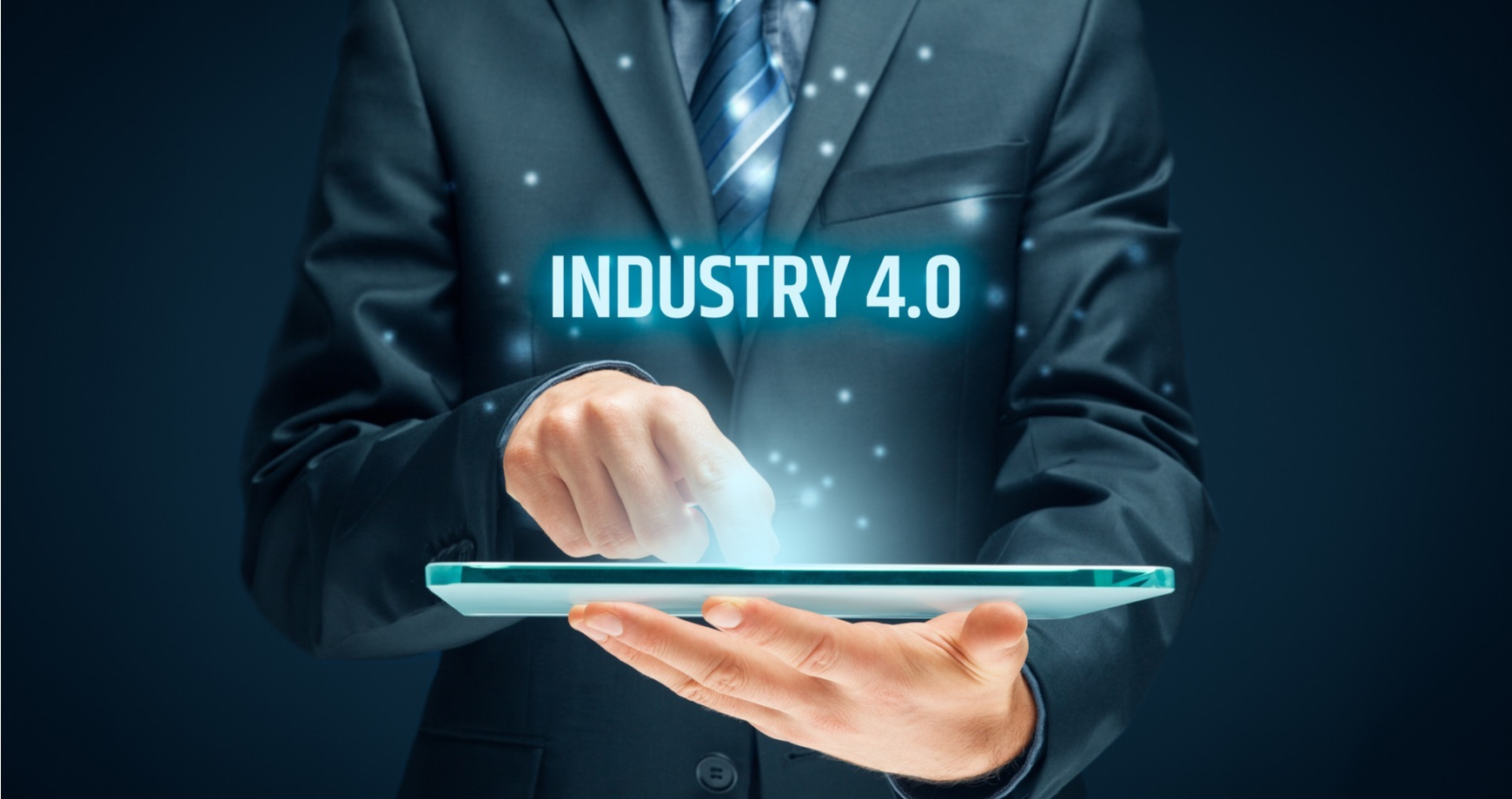 Man looking at ipad with Industry 4.0 above as text