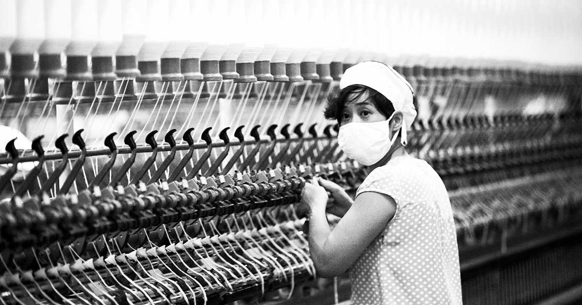 Surprised Chinese factory worker bw