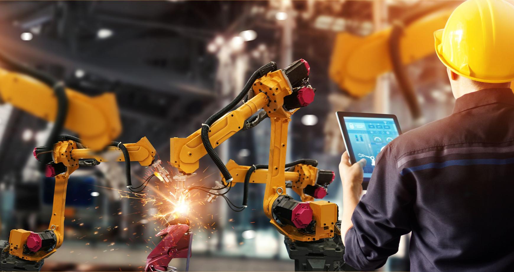 Man controlling factory machinery